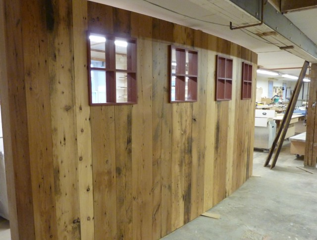 Room divider made from recycled barnboard with Valchromat barn sash.