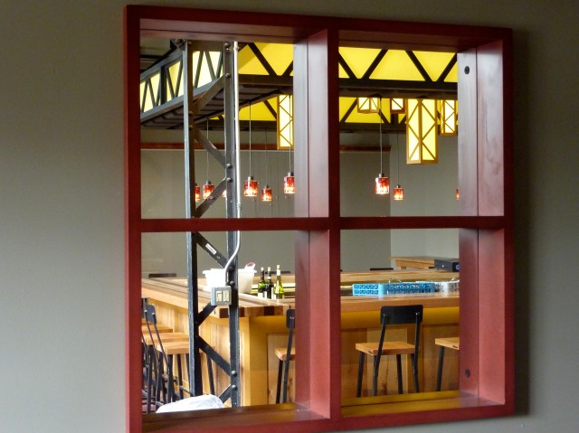Valchromat barn sash, framing on front panels of bar, and rectangular light fixtures.